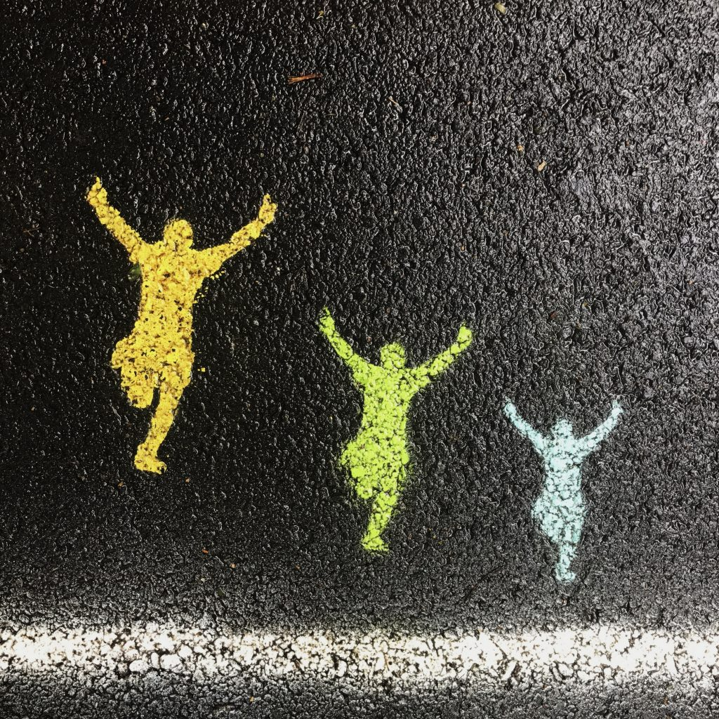 Image of runners spray painted on tarmac