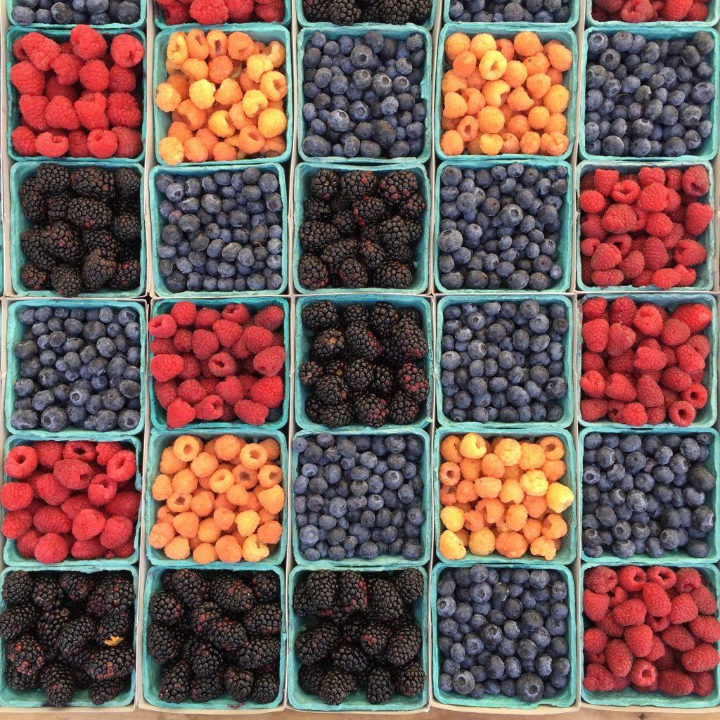 Punnets of blackberries, blueberries and raspberries