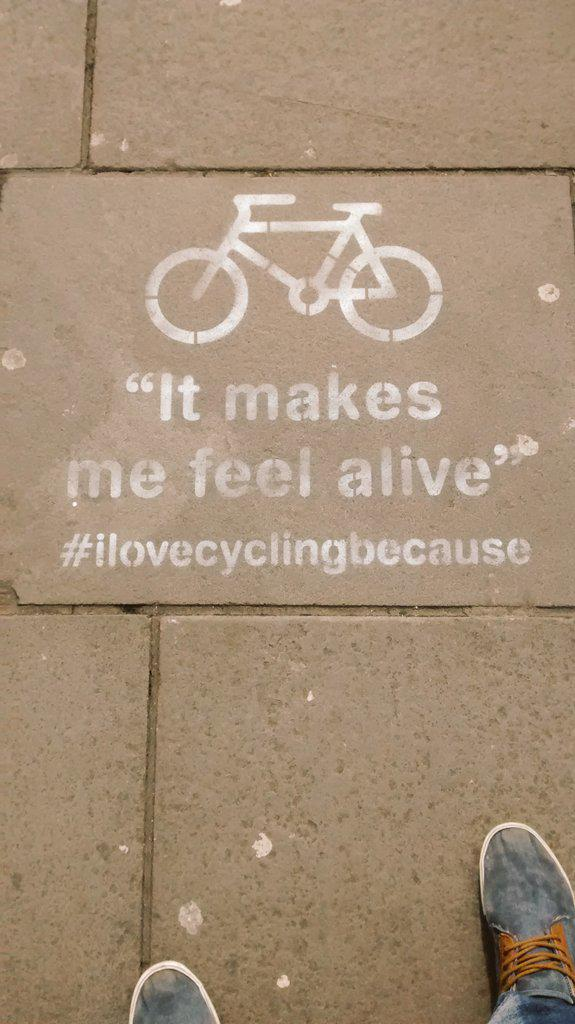 """Stencil saying """"I love cycling because it makes me feel alive"""""""