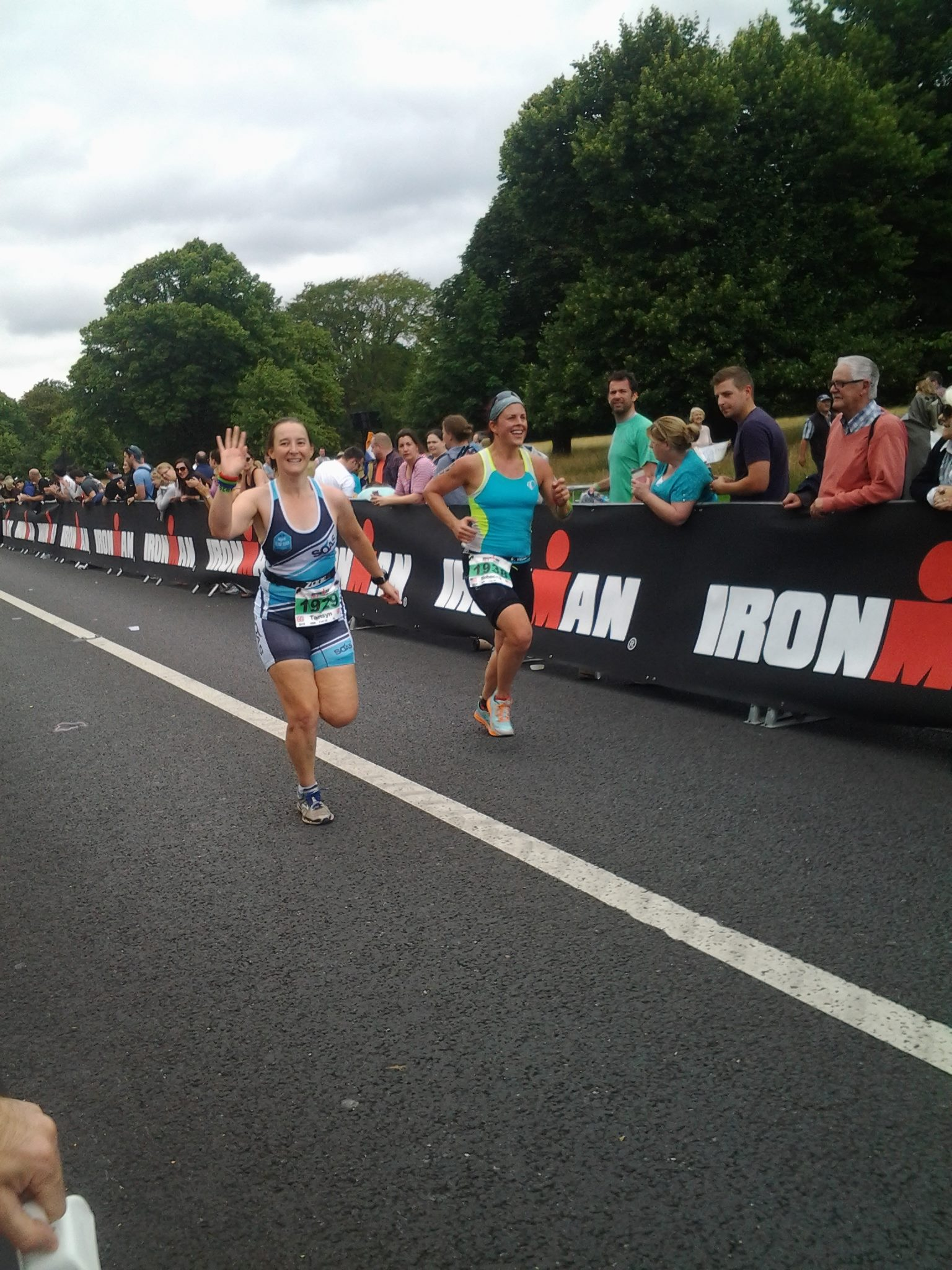 Running towards the finish line with Rebecca © Claire Cooke