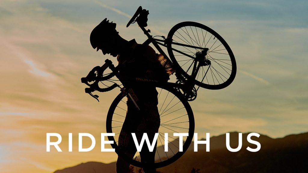RideWithUs - silhouette of a person with a road bike on their shoulder