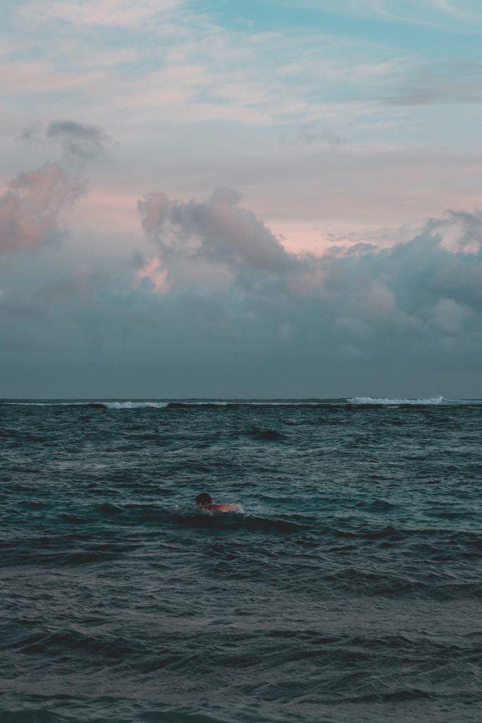 A person open water swimming in the sea