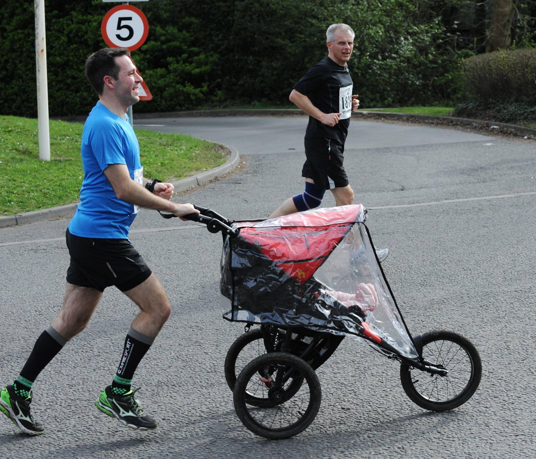 Stuart running with Baby M in a running buggy.