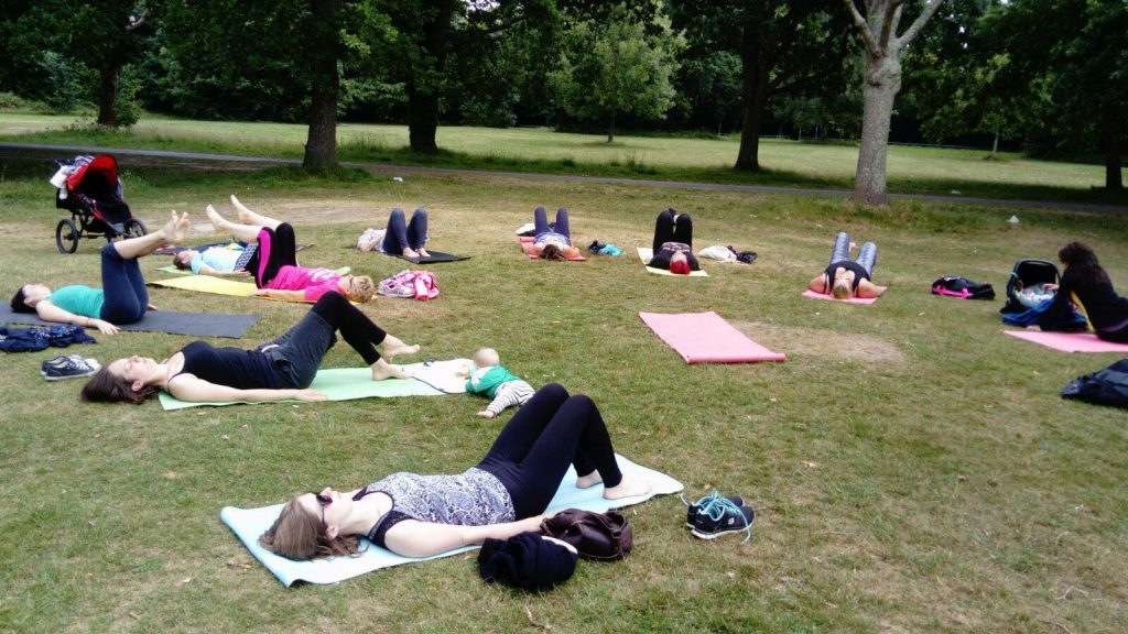 Group of people doing Pilates in the park