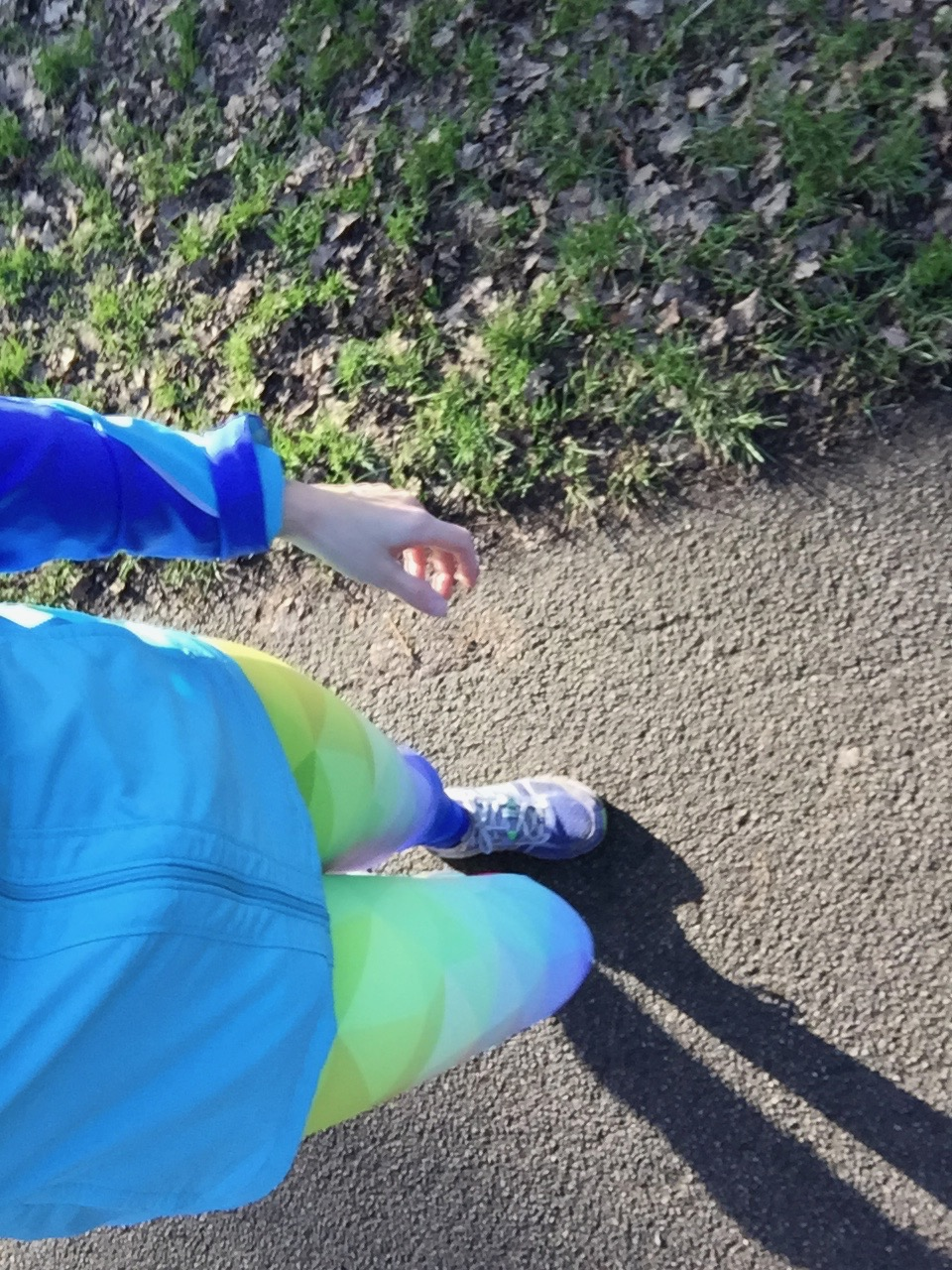 A vbird's eye view of Tamsyn's legs with brightly coloured leggings on.