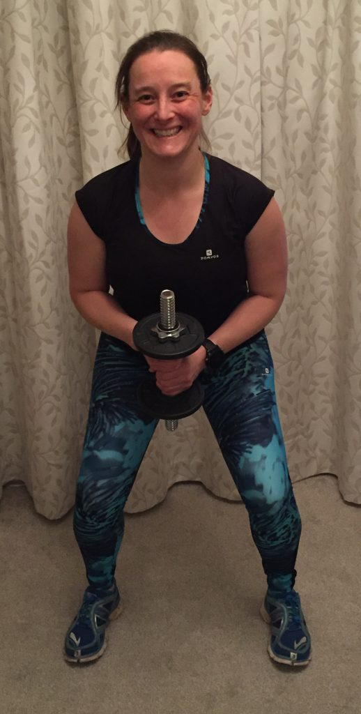 Tamsyn doing a dumbbell squat.