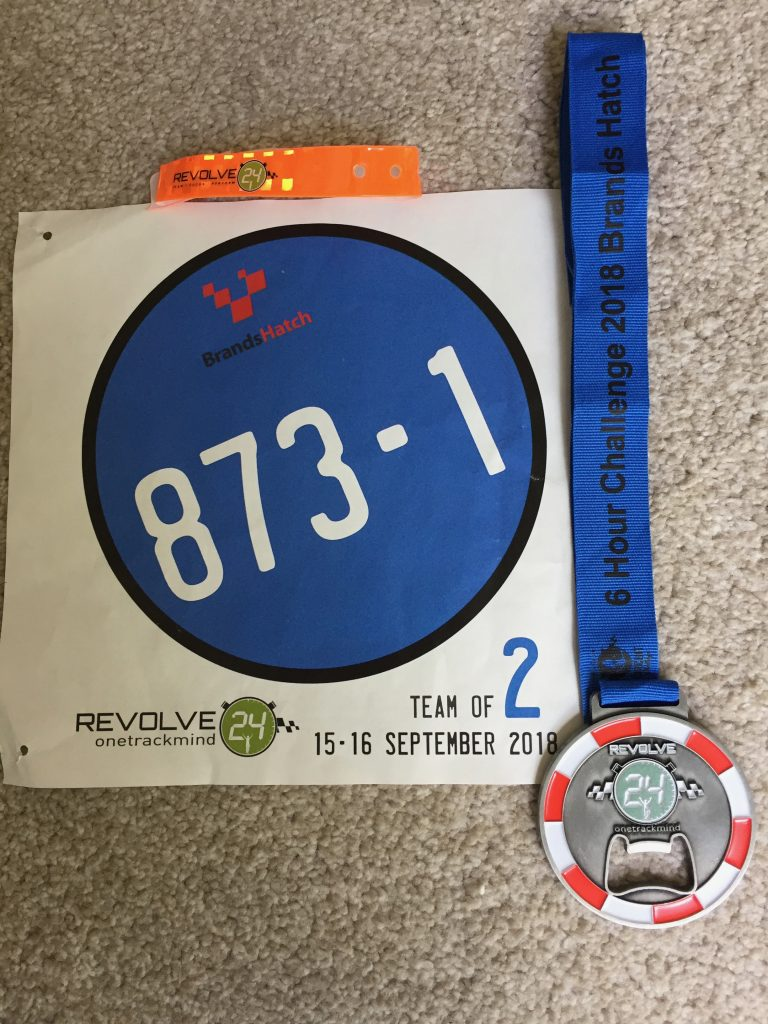 Revolve24 six hour challenge medal, wristband and race bib