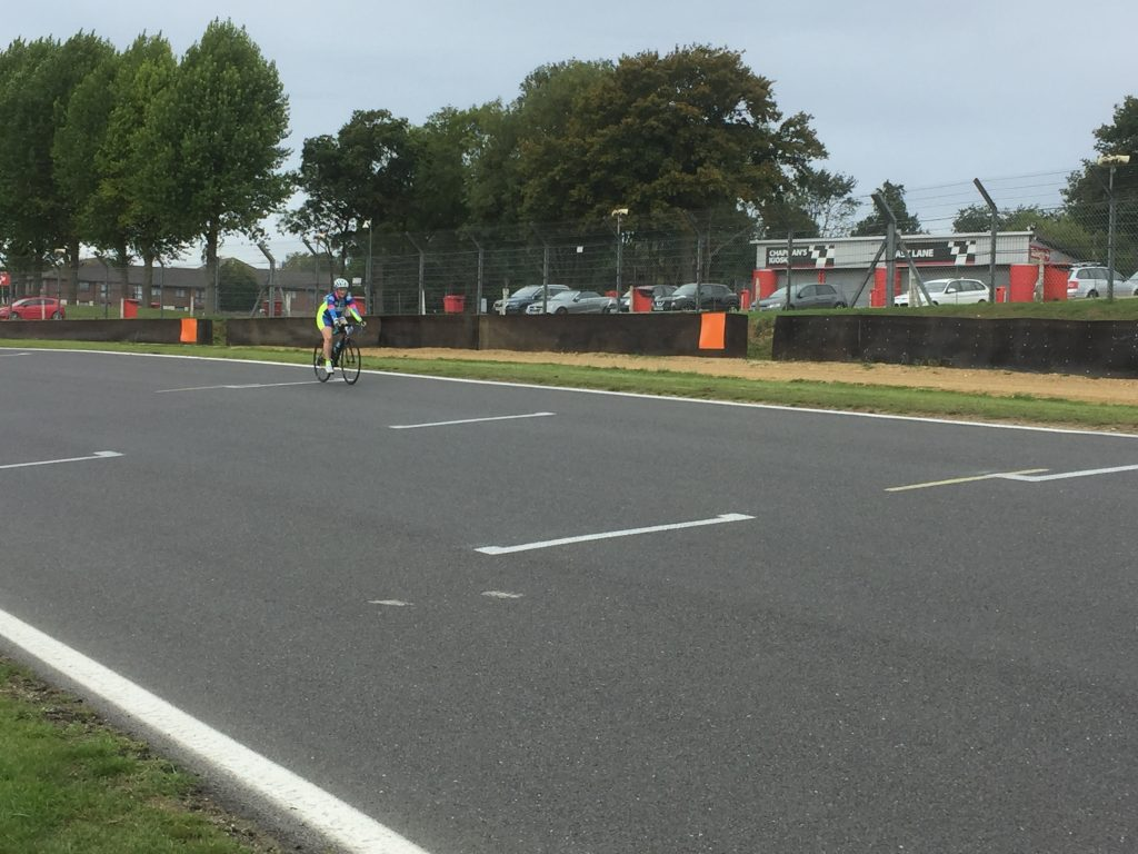 Tamsyn cycling along Brabham Straight during Revolve24