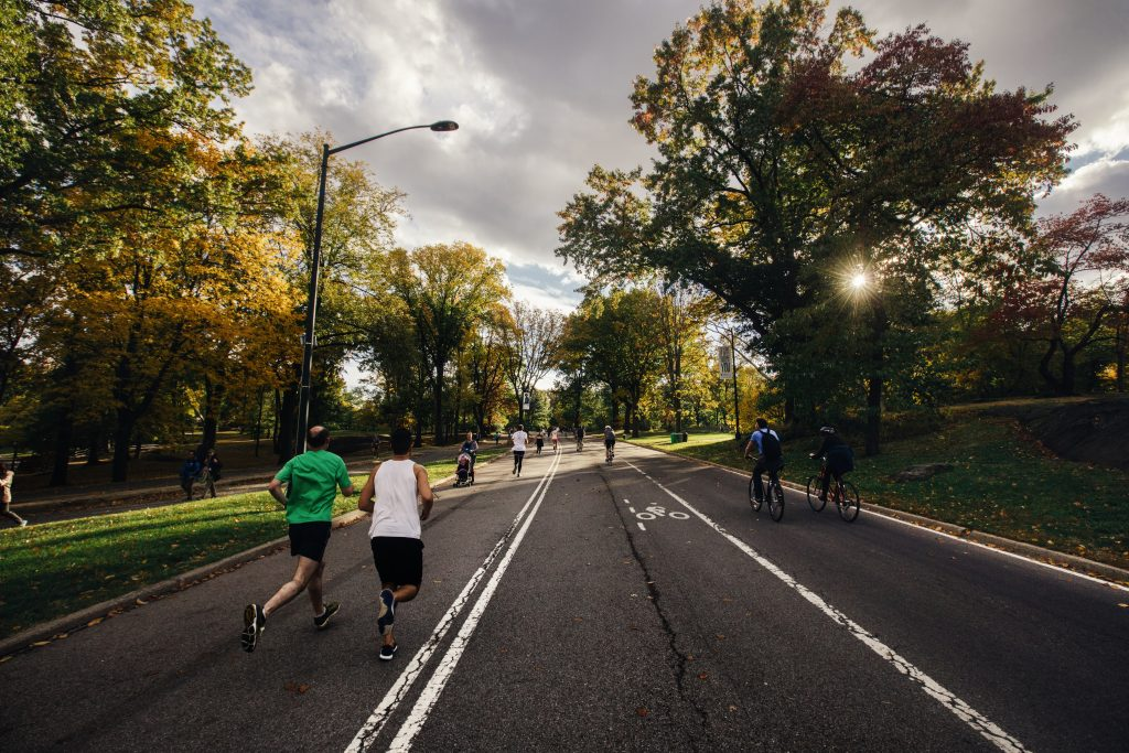 Two men jogging in Central Park, New York.