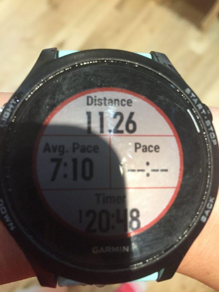Garmin watch face showing 11.26km in 1:20:48.