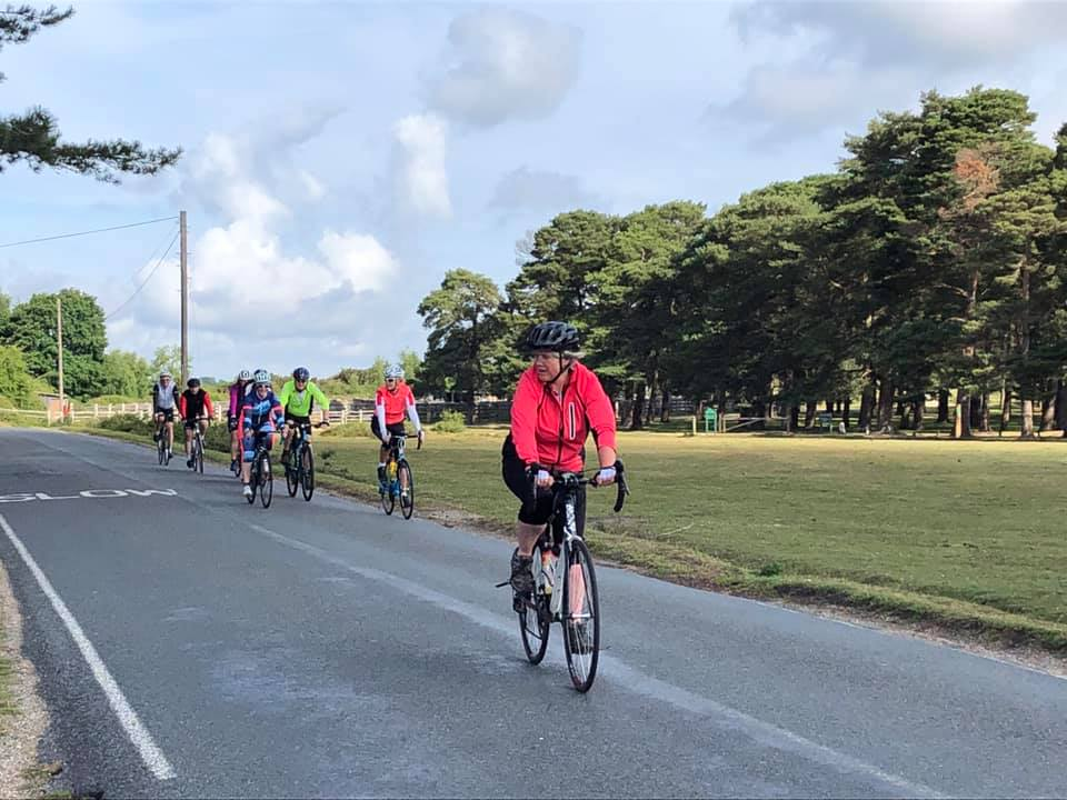 A group bike ride in the New Forest. It is a mixed group of men and women.