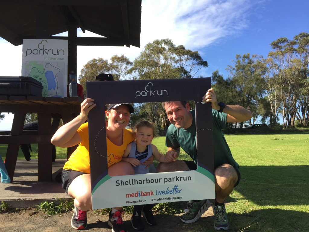 Tamsyn, M and Stuart with the Shellharbour parkrun selfie frame.