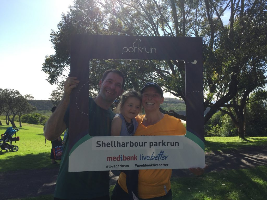 Stuart, M and Tamsyn with the Shellharbour parkrun selfie frame.