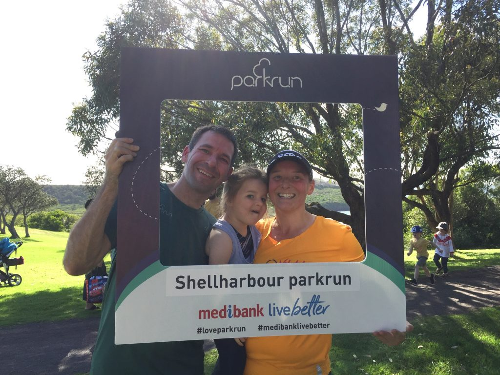 parkrun tourism! Stuart, M and Tamsyn with the Shellharbour parkrun selfie frame.