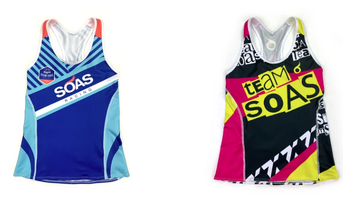 Two Team Soas tri vest next to each other. One is blue and turquoise; the other is black, white and pink with yellow text.