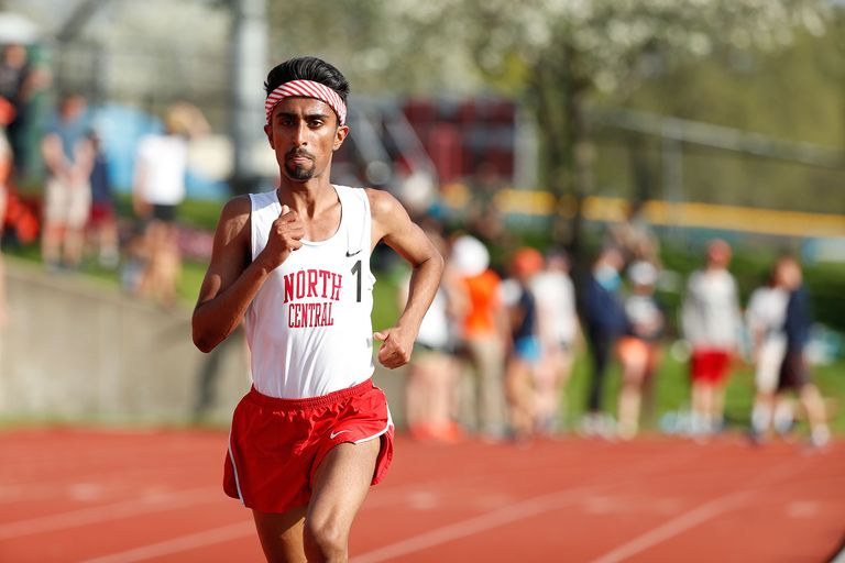 Dhruvil Patel on a runing track wearing running clothing.