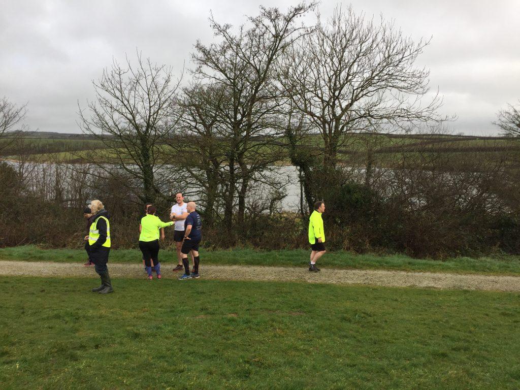 Runners near the finish at Tamar Lakes parkrun.