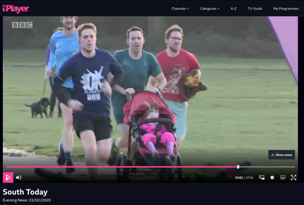 Stuart running with M at Southampton parkrun.