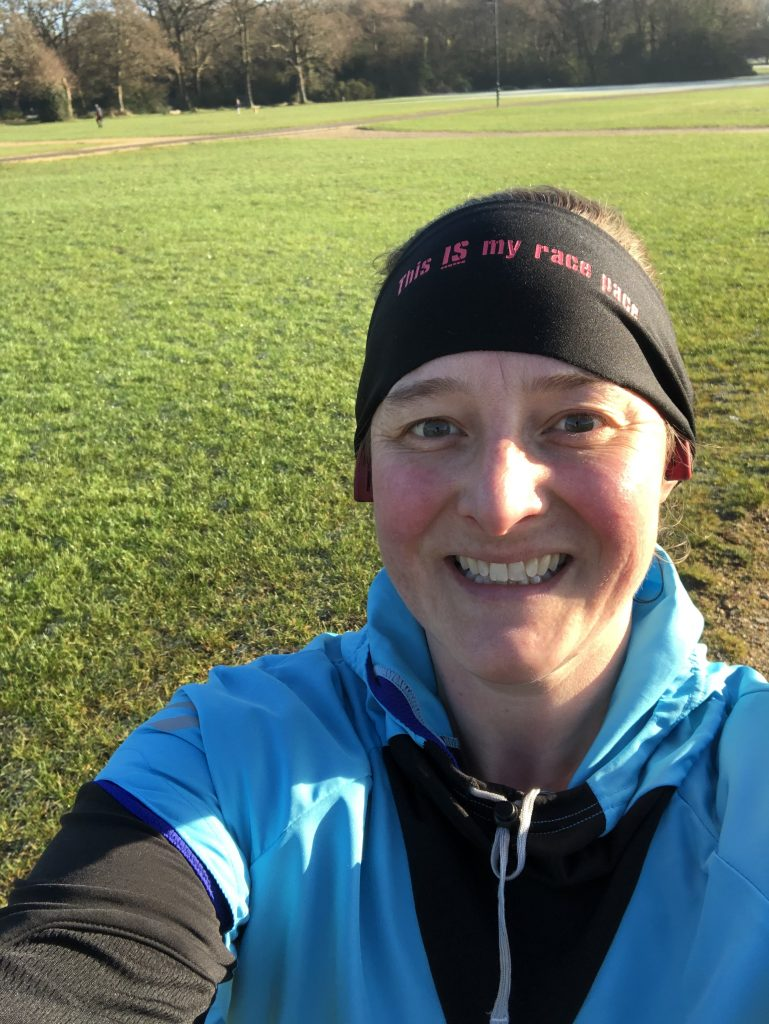 Selfie of Tamsyn on Southampton Common. Tamsyn is wearing running clothes.