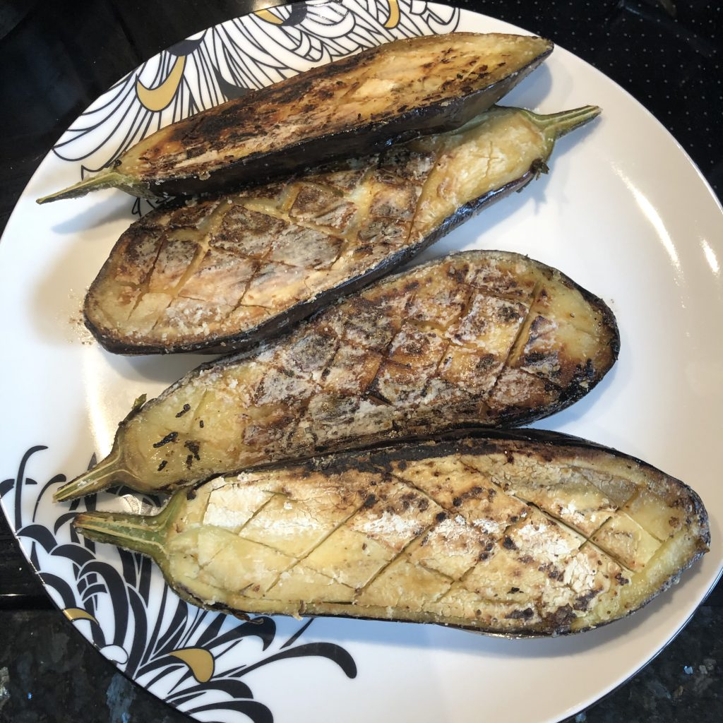 Cooked aubergines on a plate.