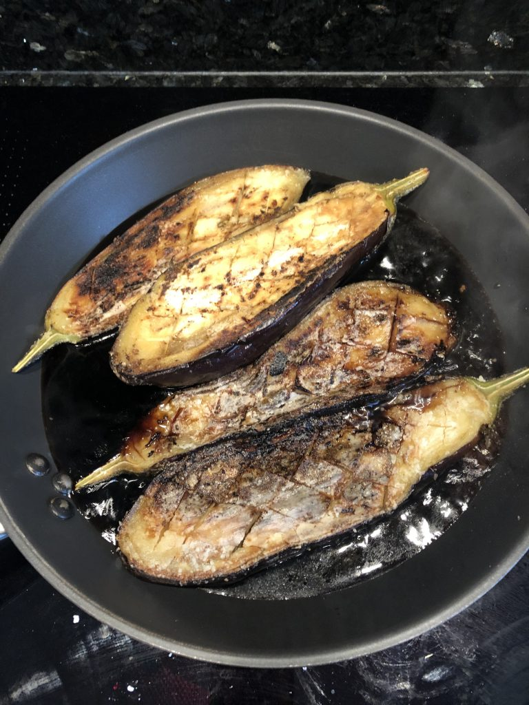 Tamsyn's cooked aubergines in a frying pan with the teriyaki sauce.