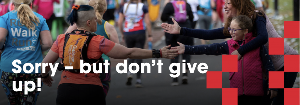Runner giving someone a high five.