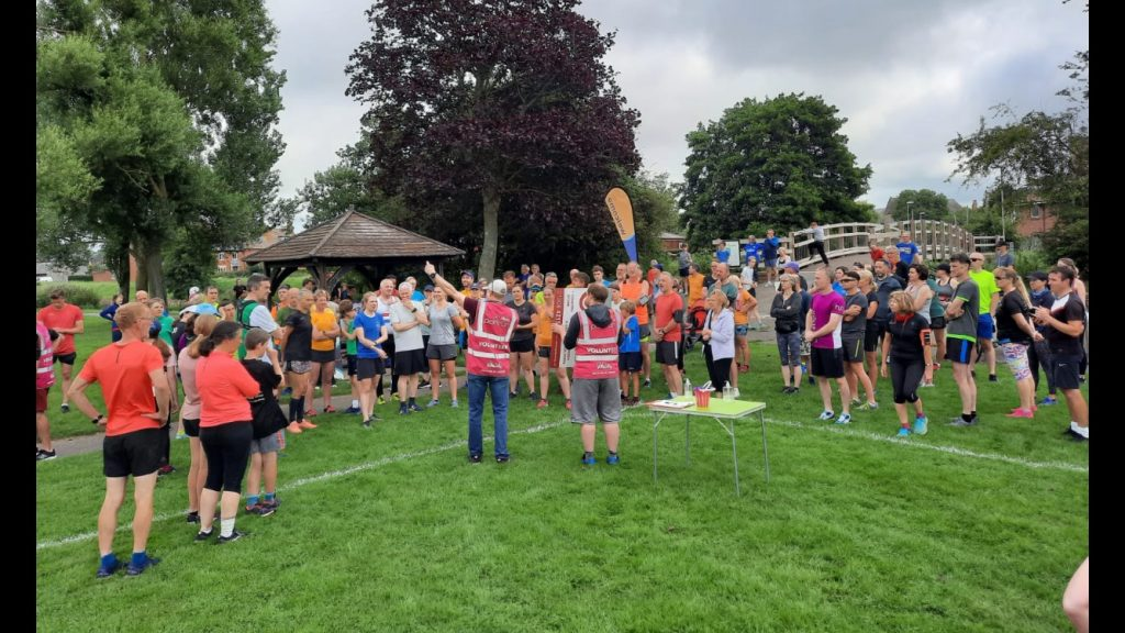 The Run Director at St Mary's parkrun giving the briefing.
