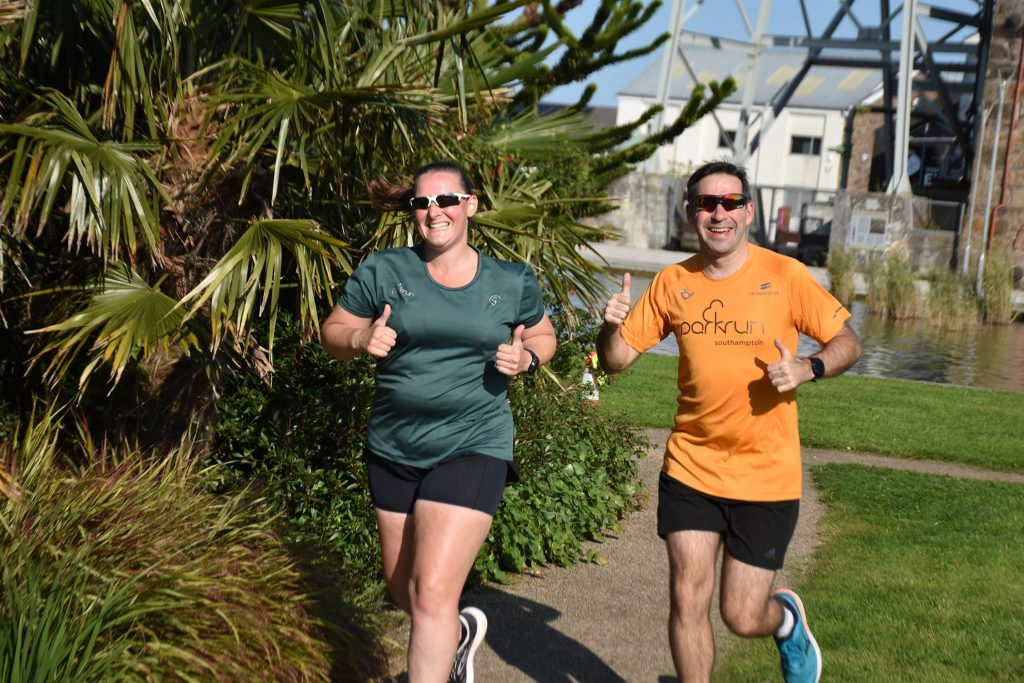 Tamsyn and Stu smiling and running.