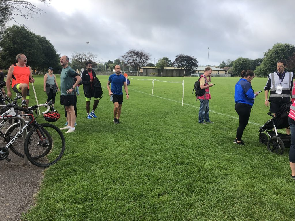People standing around before the start of St Mary's parkrun.