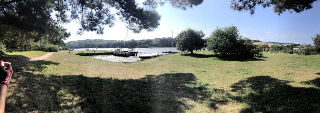 Panoramic view of a small boat harbour at Restronguet Creek.