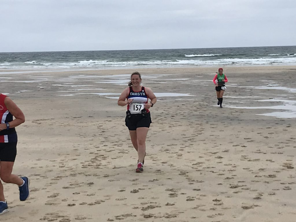Tamsyn running towards the steps from the beach at Gwithian.