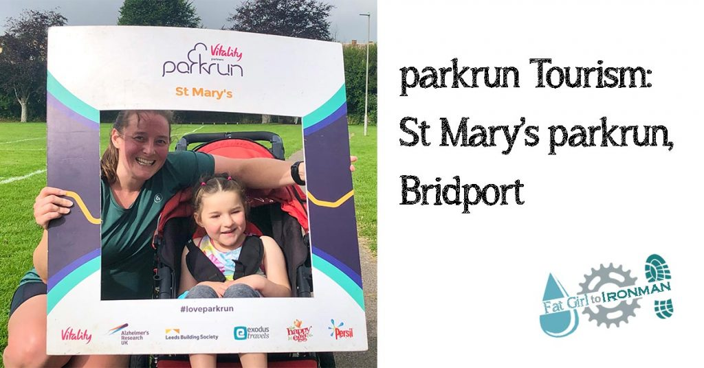 Tamsyn and M posing in the St Mary's parkrun photo frame.